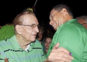 JLP Leader Andrew Holness (right) is congratulated by former party leader and prime minister Edward Seaga at JLP headquarters last night.