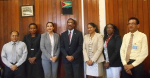 Members of the Board of the Deeds and Commercial Registries Authority. From L to R: Rafiq Khan (Guyana Bar Association), Nicole Prince (Registrar [ag] of Commerce), Bibi Shabena Ali (Chairperson), Attorney General Basil Williams, Azeena Baksh (Registrar of Deeds), Gillian Pollard (Ministry of Finance), and Shyam Doodnauth (Board Secretary)