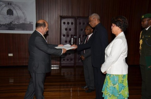 President David Granger receives the Letters of Credence from Ambassador Manuel De Jesus Teles Fazendeiro, in the presence of Vice President and Minister of Foreign Affairs, Mr. Carl Greenidge (pictured to the President's right) and Director General of the Ministry of Foreign Affairs, Ms. Audrey Waddell (first, right).