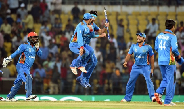 Afghanistan's players celebrate after winning the World T20 cricket tournament match against West Indies at The Vidarbha Cricket Association Stadium in Nagpur on March 27, 2016. / AFP / PUNIT PARANJPE        (Photo credit should read PUNIT PARANJPE/AFP/Getty Images)