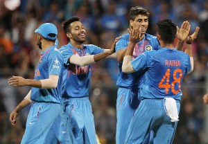 India's Ashish Nehra, second right, is congratulated by teammates after taking the wicket of West Indies Marlon Samuels during their ICC World Twenty20 2016 cricket semifinal match at Wankhede stadium in Mumbai, India,Thursday, March 31, 2016.(AP Photo/Rafiq Maqbool)
