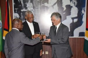 President David Granger (centre), Minister of Foreign Affairs, Mr. Carl Greenidge (first, left) and the newly installed Australian High Commissioner to Guyana, His Excellency John Pilbeam share a toast after the accreditation ceremony.