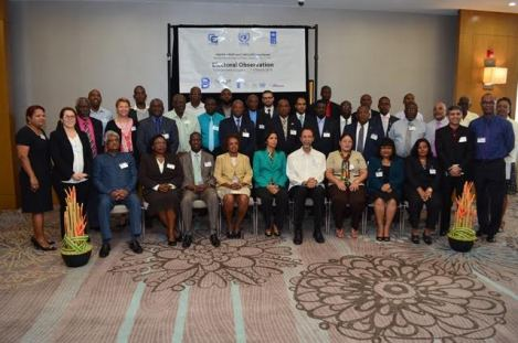 UN Resident Coordinator and UNDP Resident Representative, Khadija Musa and Deputy Secretary-General, CARICOM Secretariat Manorma Soeknandan with the participants of the  Regional workshop on Building Resources in Democracy, Governance and Elections  at the Marriott hotel