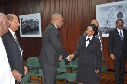 Minister of State Joe Harmon congratulates CJ Yonette Cummings-Edwards