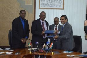 Minister of Finance Winston Jordan and Resident Representative, Export/Import (EXIM) Bank of India, T.D Sivakumar  with a signed copy of the credit agreement