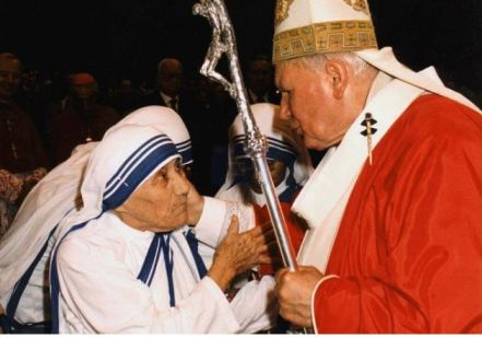 In this Sunday, June 29, 1997 filer, of Pope John Paul II greets Mother Teresa of Calcutta