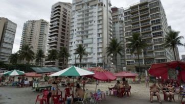 The probe centres on a luxury penthouse (centre) in the resort of Guaruja