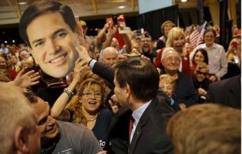 Marco Rubio, seen here playing with a cut-out of his own face, has the support of senior Republicans like Senator Bob Dole