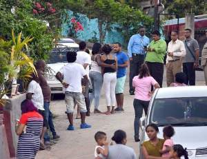 Residents of Guarata Hills Maracas Valley came out on the street after villagers Keston Charles and Anthon De Four were shot and killed yesterday. (Photo CURTIS CHASE - Trinidad Express))