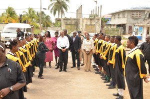 Students of the Linden Foundation Secondary School serenade President David Granger upon his arrival at the school. Minister within the Ministry of Education, Ms. Nicolette Henry is pictured at the President's left.