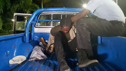 One of the gunmen was captured by the Police, seen herein the back of a Police patrol vehicle
