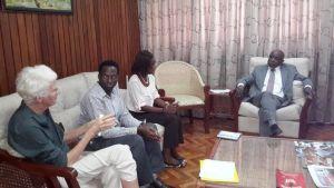 Sabine McIntosh, Joel Simpson and Schemel Patrick in conversation with Minister Greenidge