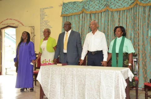 President David Granger stands with Pastor Phillip Campbell (at his right) and elders of the church during the praise and worship session at the Albion Chapel Congregational Church at Fyrish, Corentyne.