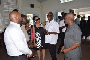 Minister of Citizenship, Winston Felix and Minister within the Ministry of Social Protection, Keith Scott interacting with family and close relatives of the late Haslyn Parris