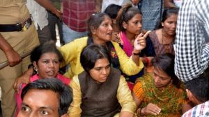 Activist leader Trupti Desai, centre bottom, vowed they would try again. (AFP photo)