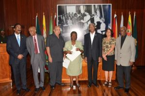 President David Granger and Attorney General (extreme left) with the newly sworn in members of the Advisory Council on the Prerogative of Mercy