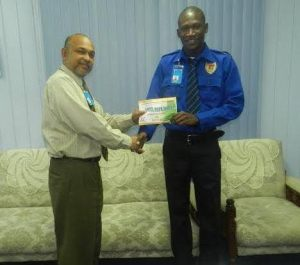 Mr. Hopkinson [left] received his cash incentive from Andre Kellman, the airport's Deputy Chief Executive Officer on April 20th, 2016.