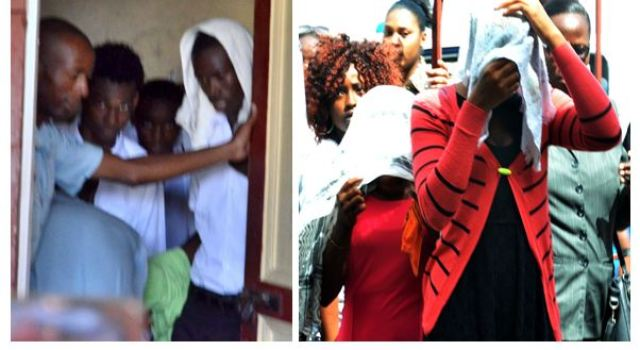 The teens covered their faces from the media and scores of curious onlookers gathered outside the Court
