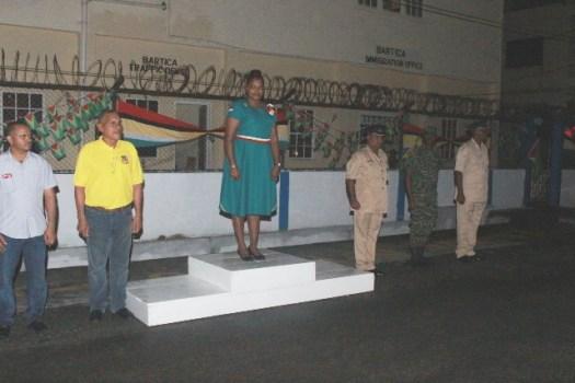 (Left to Right) REO (ag) of Region 7 Derek Persaud, Regional Chairman Gordon Bradford and Minister Anette Ferguson taking the salute.