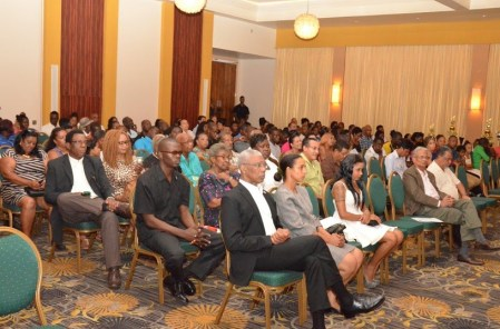 President David Granger seated in the audience at the lecture. Minister of Education, Dr. Rupert Roopnaraine is pictured second from right in the first row.