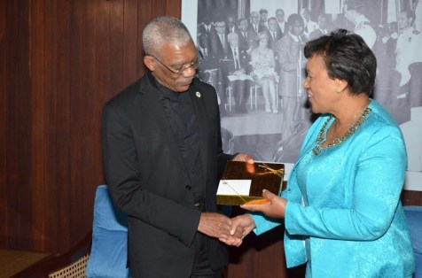 President David Granger presents a token to Secretary-General of the Commonwealth of Nations, Baroness Patricia Scotland, during a courtesy call, this morning, at the Ministry of the Presidency.