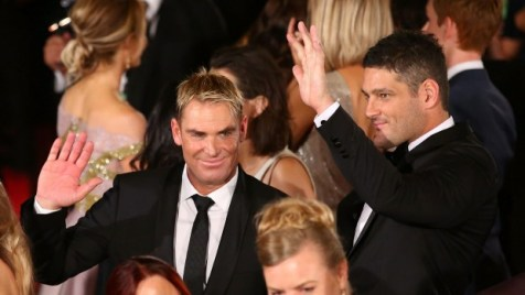 Shane Warne, left, and former AFL player Brendan Fevola arrive at the Logie awards on Sunday night. On Wednesday night their hire limo was stolen in Geelong.