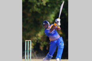 Barbados Pride opener Dwayne Smith hits down the ground during his top score of 86 against Jamaica Scorpions in the Regional Super50 yesterday. (Jamaica Observer photo)