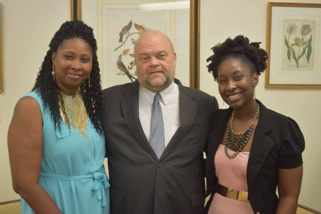 Kelly Hyles (extreme right), along with her mother pose for a photo op with U.S. Ambassador Perry Holloway.