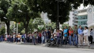 Venezuelans often have to queue for hours outside supermarkets to get the basics (Reuters photo)