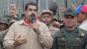 Gen Vladimir Padrino (right) stood shoulder to shoulder with President Maduro (Reuters photo)