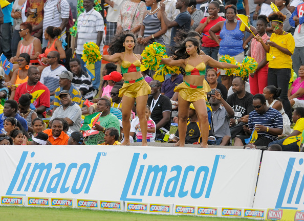 BASSETERRE, ST. KITTS AND NEVIS - AUGUST 16: Cheerleaders of Guyana Amazon Warriors cheer for their team during the Limacol Caribbean Premier League 2014 final match between Guyana Amazon Warriors and Barbados Tridents at Warner Park on August 16, 2014 in Basseterre, St. Kitts and Nevis. (Photo by Randy Brooks/LatinContent/Getty Images)