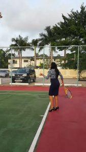 Marketing Manager Ms. Pamela Binda serves the first ball
