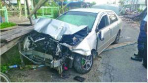 Basdeo's abandoned car mangled on Market Road, Annandale
