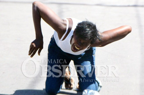 Claudette Matthews wails after her twin sons, Ramone and Rameish Cummings, were shot dead by police yesterday. (Photo: Jamaica Observer/ Lionel Rookwood)