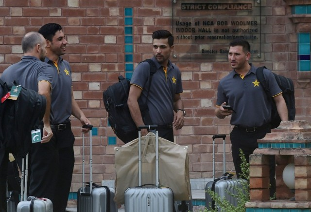 Pakistan fast bowler Mohammad Amir (2R) talks with teammates at the cricket academy in Lahore on June 18, 2016 ahead of the team departure for London. (Photo credit: ARIF ALI/AFP/Getty Images)