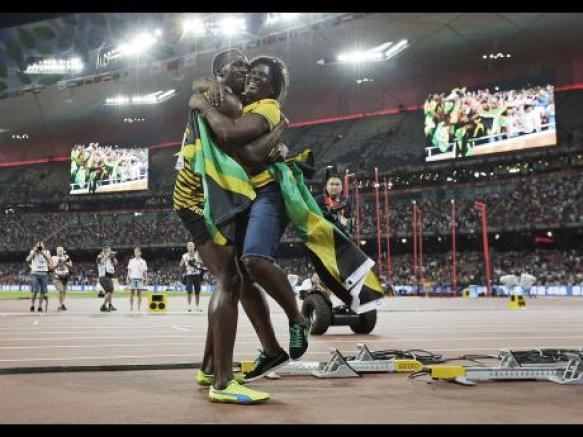 In this August 23, 2015 file photo, Jamaica's Usain Bolt hugs his mom, Jennifer Bolt, after winning the men's 100m final at the World Athletics Championships at the Bird's Nest stadium in Beijing. (AP photo)