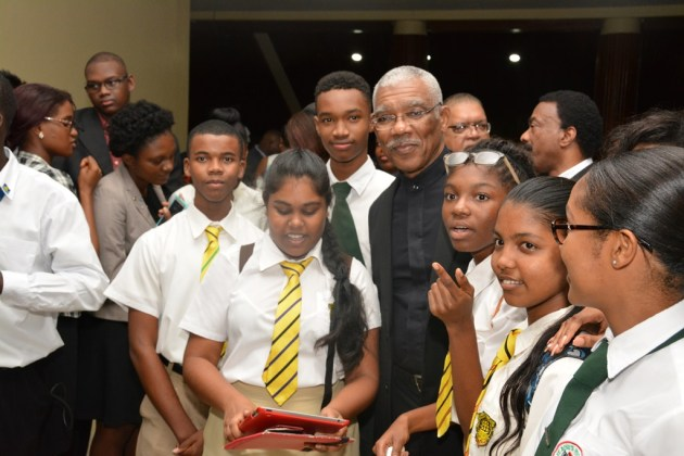 President David Granger grants a photo  opportunity to these students, who attended the Opening Ceremony of the CARICOM Heads of Government Meeting.