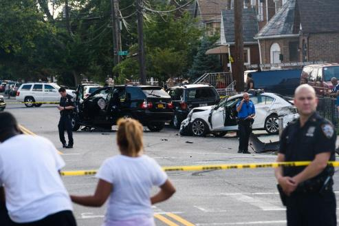 The cowardly BMW driver fled the scene after he struck a red Toyota Corolla and a few parked vehicles.(GARDINER ANDERSON/FOR NEW YORK DAILY NEWS)