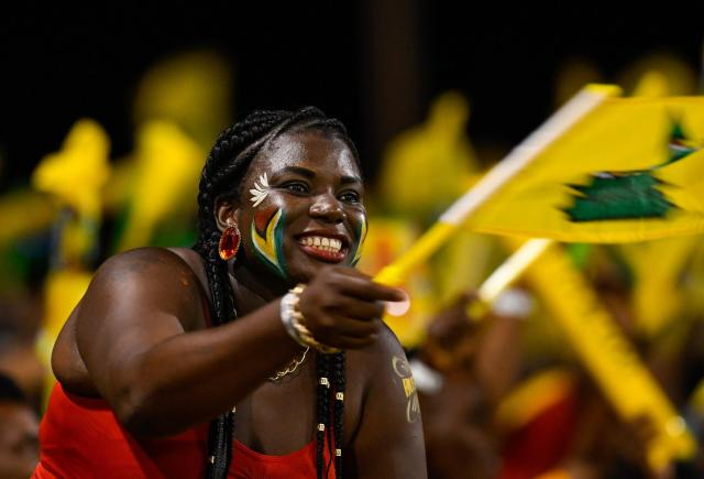 A fan of the Guyana Amazon Warriors cheering in support of her team