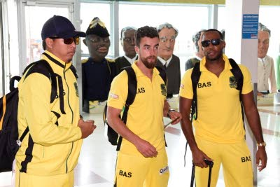 (From left) Jamaica Tallawahs players Jonathan Foo, Alex Ross and Garey Mathurin shortly after the team arrived at the Norman Manley International Airport yesterday. (Lionel Rookwood/ Jamaica Observer)
