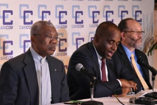 Centre: Caribbean Community Chairman, Prime Minister of Dominica, Roosevelt Skerrit at the closing ceremony of the CARICOM Heads Regular Meeting. Also in the photo are; Guyana's President, David Granger who co-hosted the Heads Conference, and Secretary General of CARICOM, Ambassador Irwin La Rocque. (GINA photo)