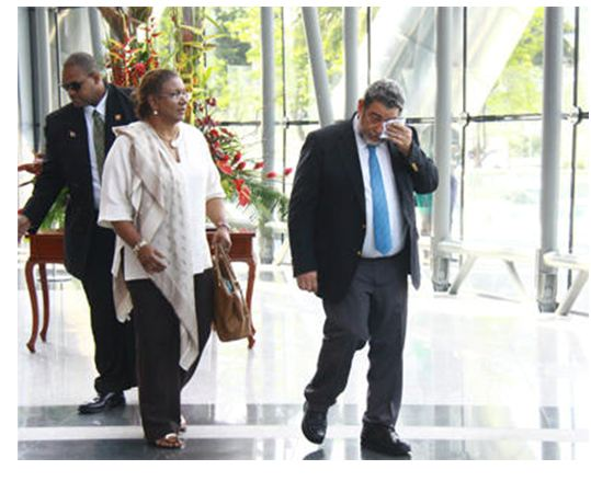 St Vincent and the Grenadines Prime Minister Dr Ralph Gonzalez wipes away his tears after viewing the body of his close friend, former prime minister Patrick Manning, as it lay in state at the National Academy for the Performing Arts in Port-of-Spain yesterday. (Photo: MARCUS GONZALES/TT Guardian)