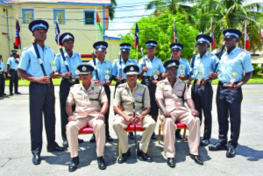 From right: Assistant Commissioner Dale Alves, Commissioner Seelall Persaud and Senior Superintendent Force Training Officer (ag) R Andries-Junor with the group of best students