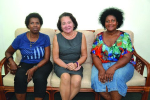 First Lady Sandra Granger (centre) is flanked by Joycelyn Thomas-Wilson (left) and Dorrie Thomas-Crawford at her State House office