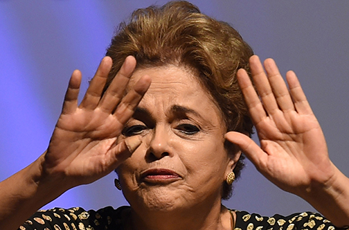 Brazilian President Dilma Rousseff gestures during the opening ceremony of the 4th National Policy Conference on Women in Brasilia on May 10, 2016. Rousseff vowed Tuesday to serve out her full term, on the eve of a Senate vote on opening an impeachment trial that could mark her last day in office. Rousseff is accused of using accounting tricks and unauthorized state loans to boost public spending during her 2014 re-election campaign. She argues the same accounting techniques were used regularly by previous governments and fall far short of an impeachable offense. / AFP PHOTO / EVARISTO SA