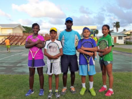 National tennis team (from L-R) Sekai Akilah Jones, Vadeanand Resaul, Coach Leyland Leacock, Adesh Khayyam and Sarah Klautky