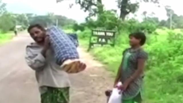 Dana Manjhi carried his wife's body on shoulders as he was denied a mortuary van or ambulance by hospital authorities. (Photo credit: OTV Video Grab)