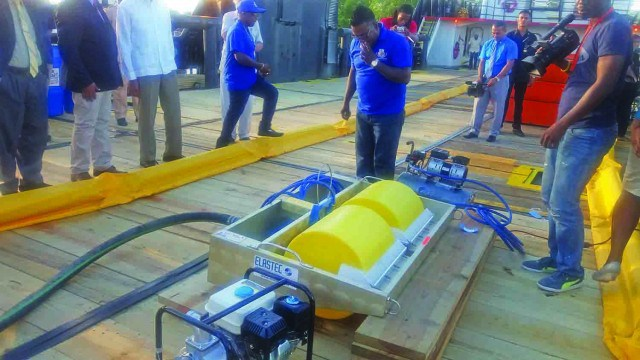 A Gaico employee demonstrating how the oil spill machine is operated