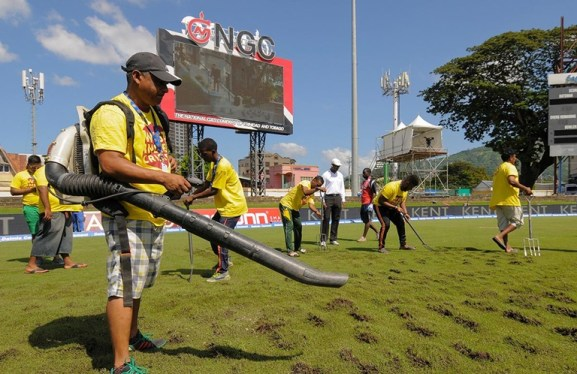 The Queen's Park ground staff attempt to dry the outfield (Getty Images)