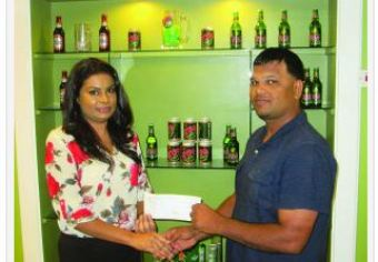 Ansa McAl Public Relations Officer,Ms Darshanie Yusuf presents the sponsorship cheque to RHTY&SC Executive Member Mark Papannah